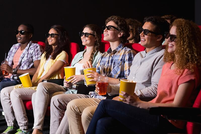 Young friends watching a 3d film at the cinema.jpeg